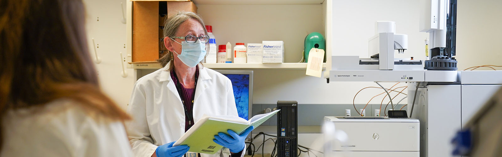 Dr. Anderson in lab wearing mask.